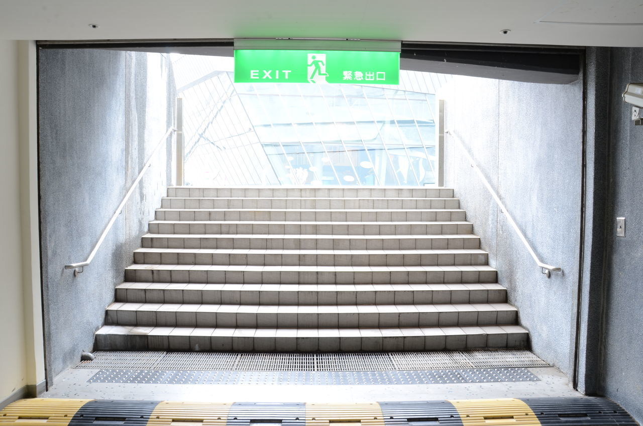 steps and staircases, staircase, steps, text, communication, railing, exit sign, the way forward, guidance, built structure, architecture, indoors, no people, stairs, low angle view, day, hand rail