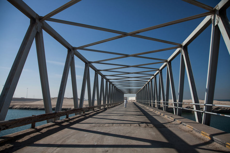 Architecture Beach Bridge - Man Made Structure Built Structure City Cityscape Connection Day Girder No People Outdoors Sea Shadow Sky Suspension Bridge The Way Forward Water