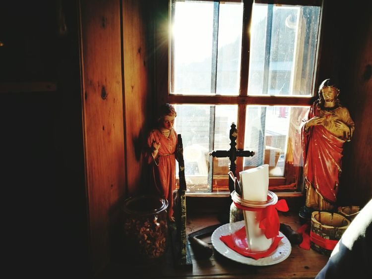 Window Indoors  Table Home Interior Day No People Altars Worship Places Devotion Devoted Devotion And Love Christian Catholic Catholic Faith Faith Intimate Intimacy Intimate Moments Light And Shadow Sunbeam Windows Window Frame Indoors  Looking To The Other Side Tranquil Scene