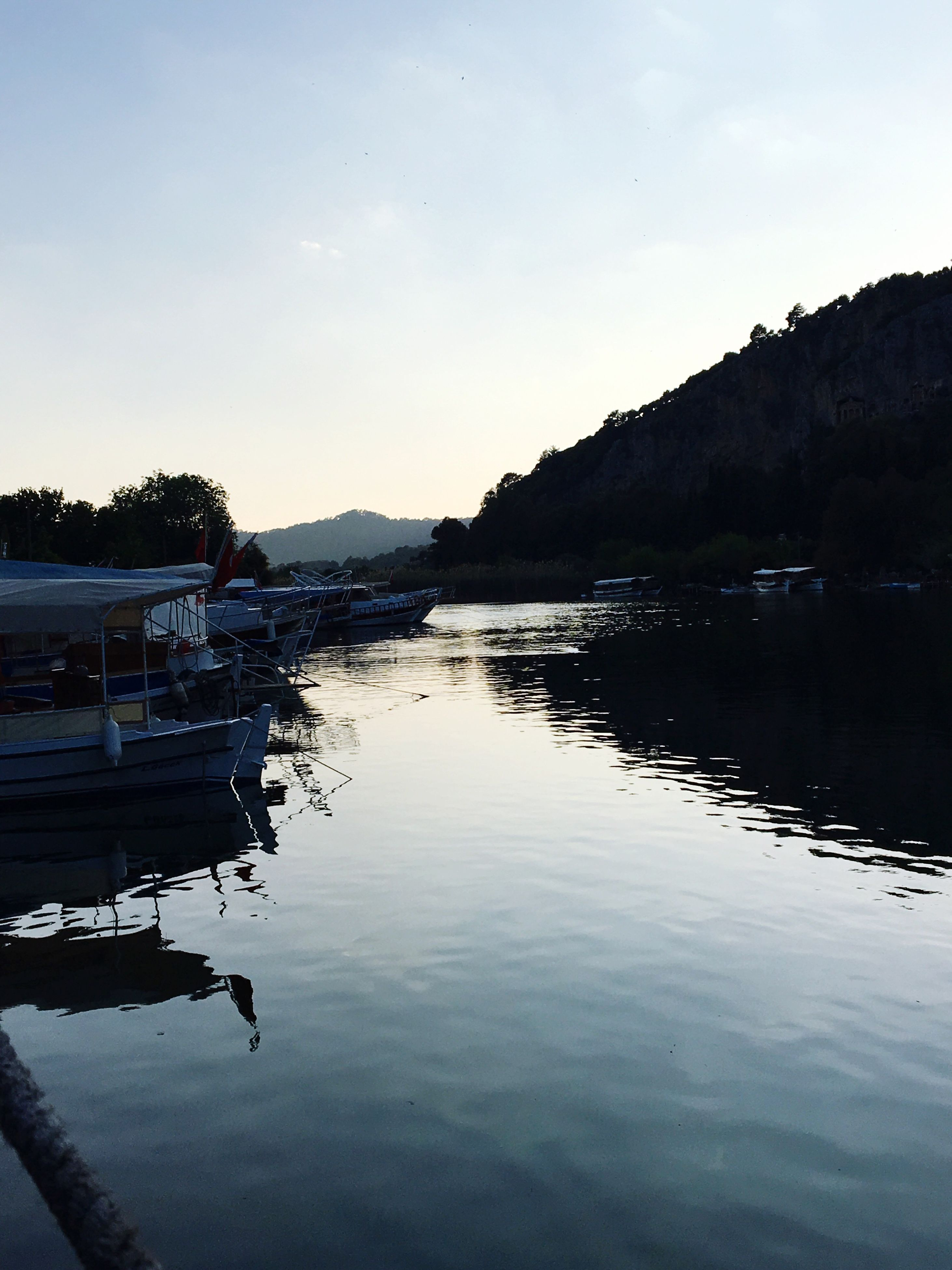 reflection, water, sky, nature, tree, beauty in nature, outdoors, lake, nautical vessel, tranquility, scenics, no people, mountain, day