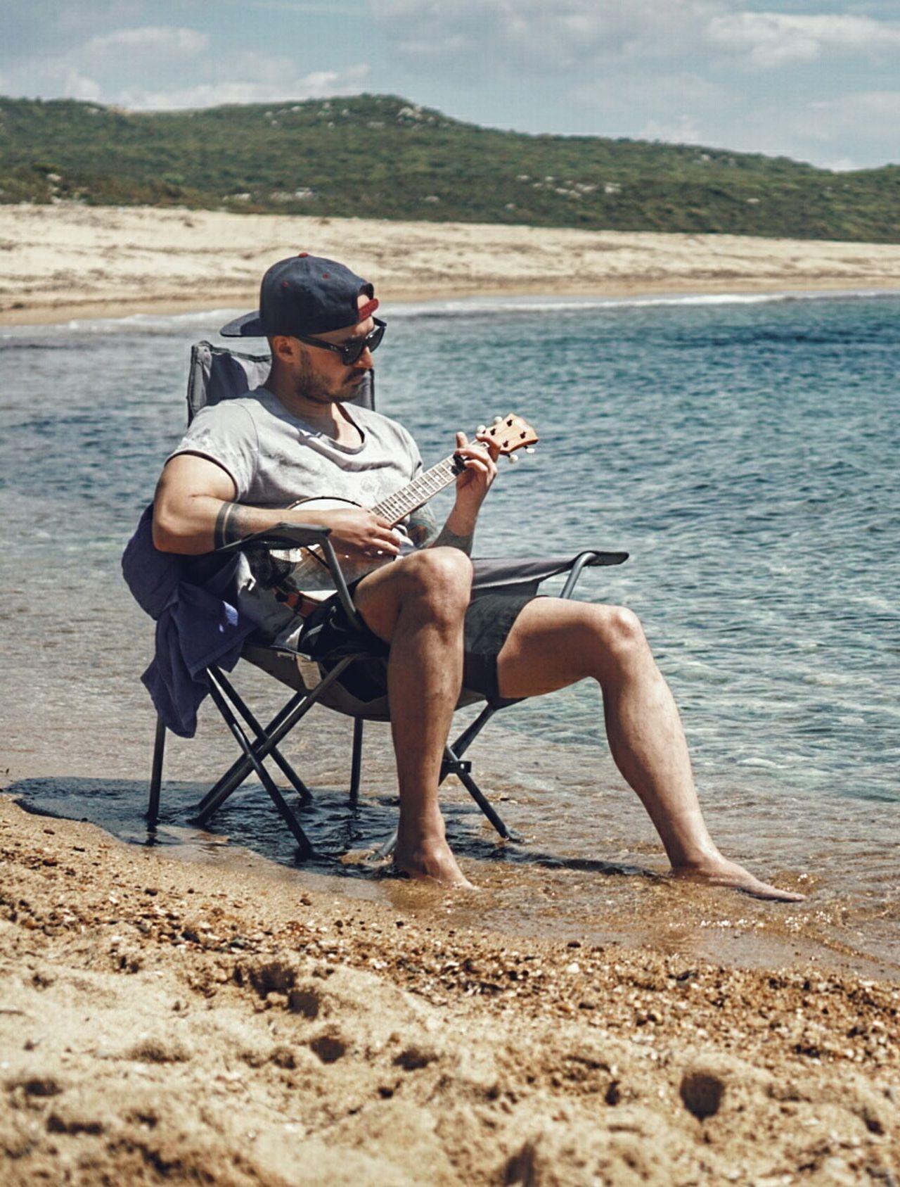 This is the Beach called Uzunkum in Saroz Turkey . This Cool Guy with Banjo is one of my best friends @cem_celik He is also a great photographer. Check his portfolio. Eye4photography  EyeEm Best Shots EyeEmBestPics EyeEmbestshots