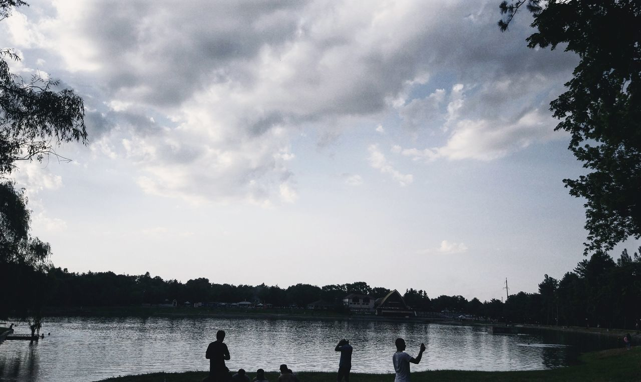 Water Lake Silhouette Cloud - Sky Sky Leisure Activity Tranquility Outdoors Tree Nature Day Scenics Beauty In Nature People Vacations One Person Adult Bird