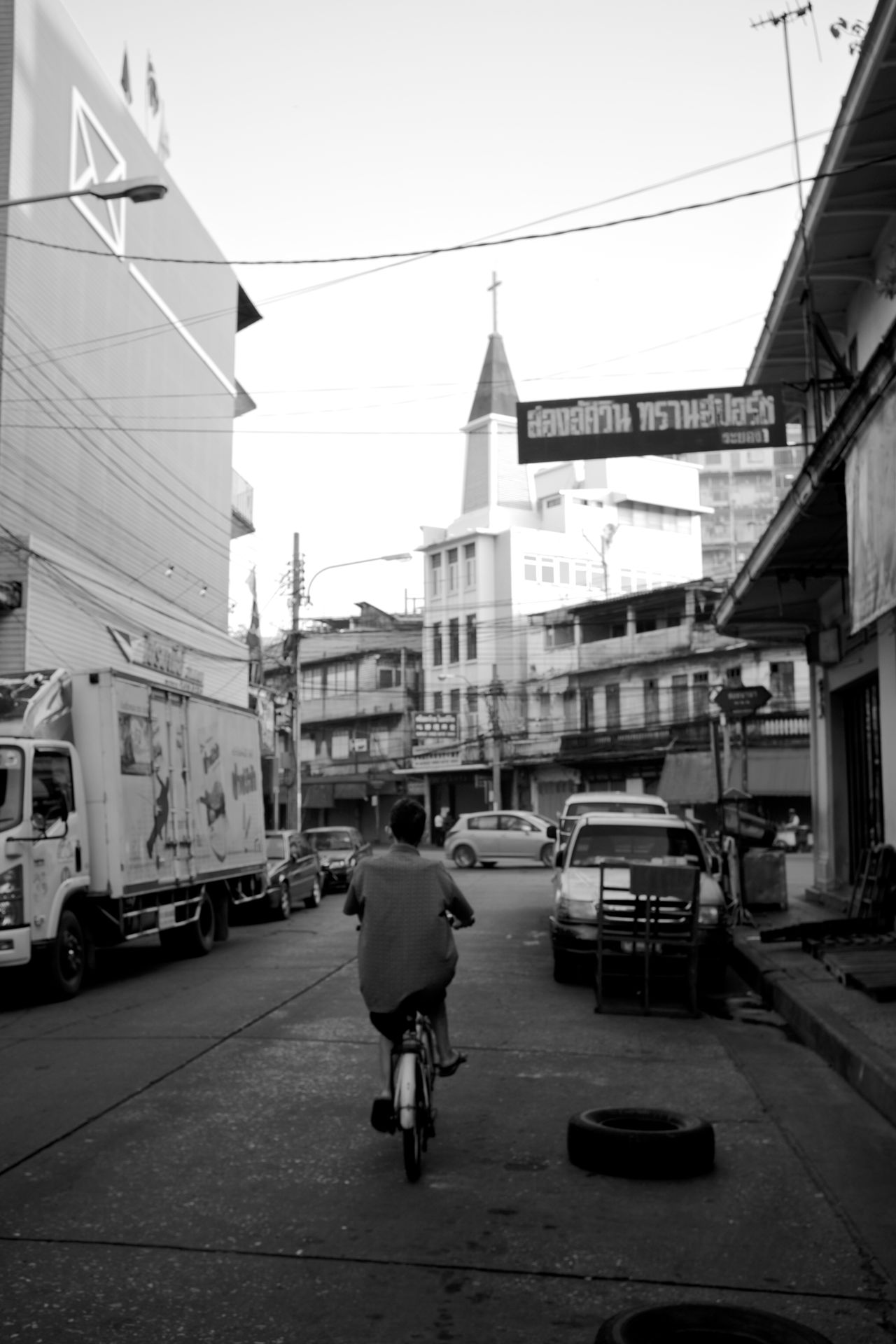 postcards from bangkok. B&w Street Photography Bangkok Bicycle Building Exterior City City Life City Street Early Morning Light Everybodystreet Fujifilm_xseries Man On A Bicycle Mode Of Transport Monochrome Real People Riding A Bicycle Street Photography Thailand Thailand_allshots The City Light Urban Urban Lifestyle Urban Skyline Urbanphotography