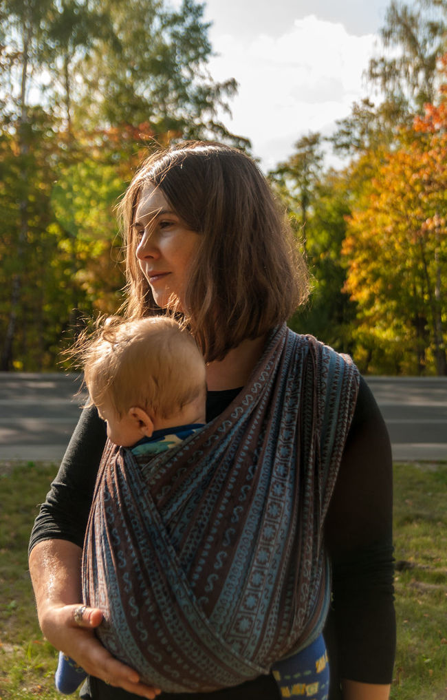 A delightful day for two of us Baby Baby Sling Baby Wrap Babywearing Casual Clothing Childhood Day Front View Happiness Leisure Activity Lifestyles Maternity Motherhood Parenting Person Portrait Real People Sling Smiling Waist Up Young Adult Young Women