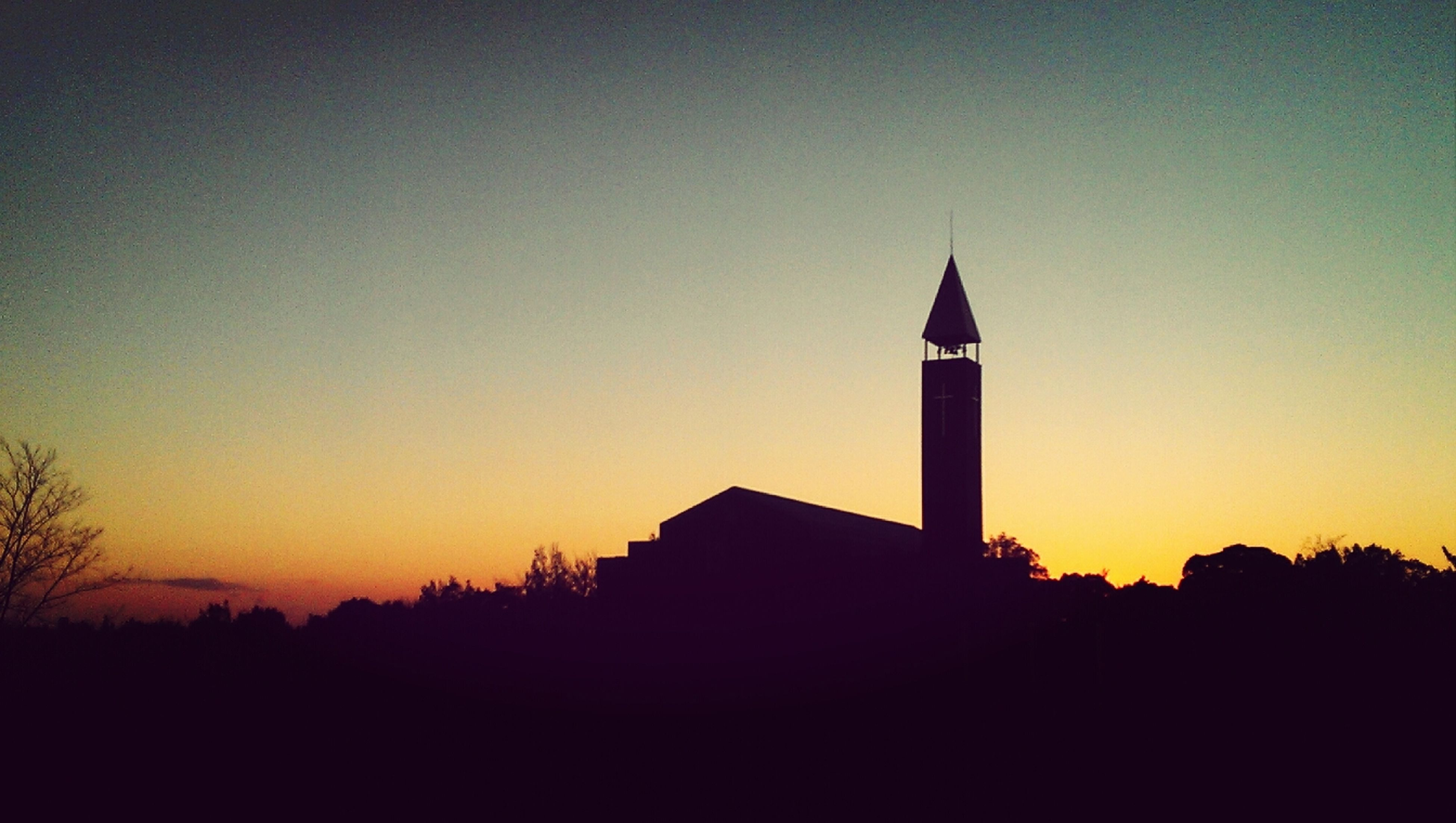 architecture, building exterior, built structure, sunset, silhouette, tower, religion, clear sky, place of worship, copy space, low angle view, spirituality, church, spire, orange color, clock tower, steeple, no people, sky