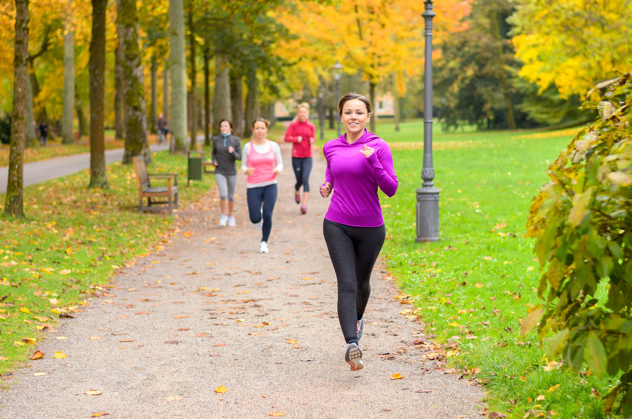 exercising, healthy lifestyle, sports clothing, only women, jogging, full length, adults only, women, vitality, adult, lifestyles, young adult, relaxation exercise, smiling, nature, wellbeing, young women, outdoors, day, people, togetherness, tree, real people