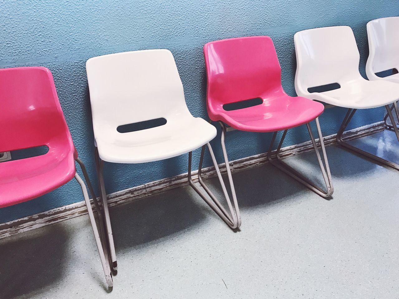 Indoors  No People Close-up Choice Chairs Blue Pink Color In A Row Side By Side Still Life Day