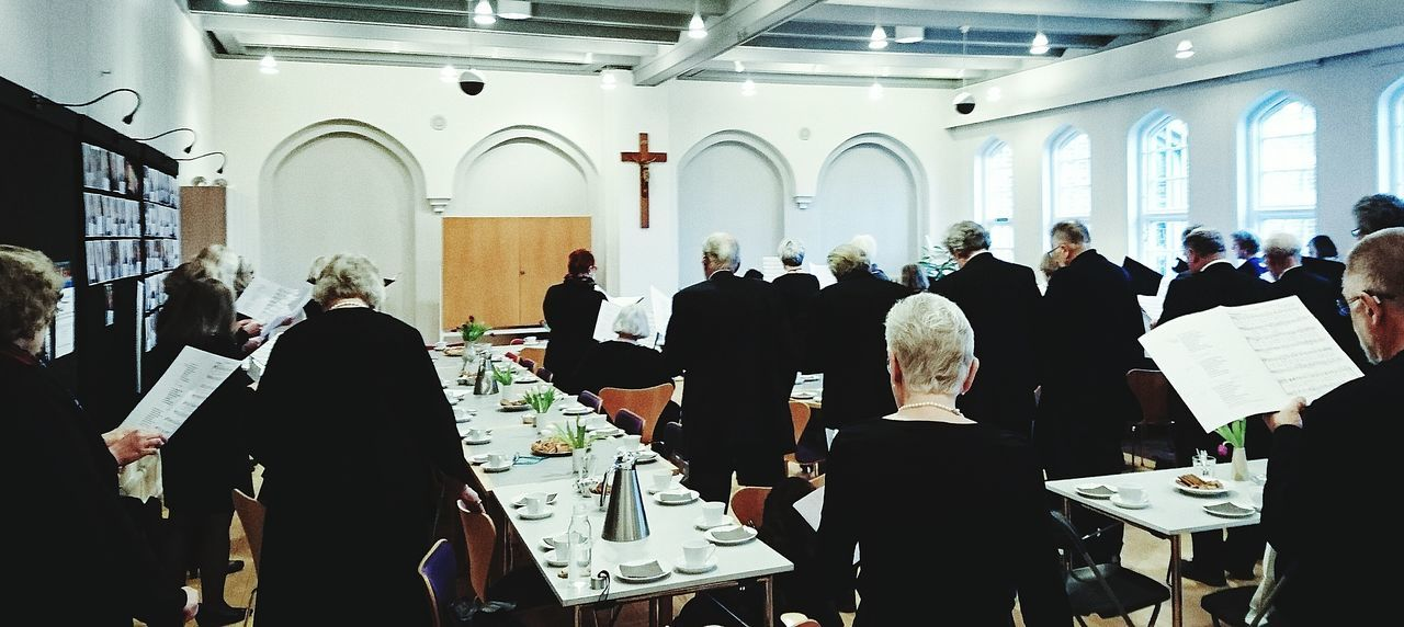 Practice before a funeral Choir  Messiahchurch Singing Black Peolple And Places Saying Goodbye Messiaskirken Singing Denmark Charlottenlund Funeral At Work Large Group Of People Ceremony Men Full Length Indoors  Adults Only People Place Of Worship Adult Headwear