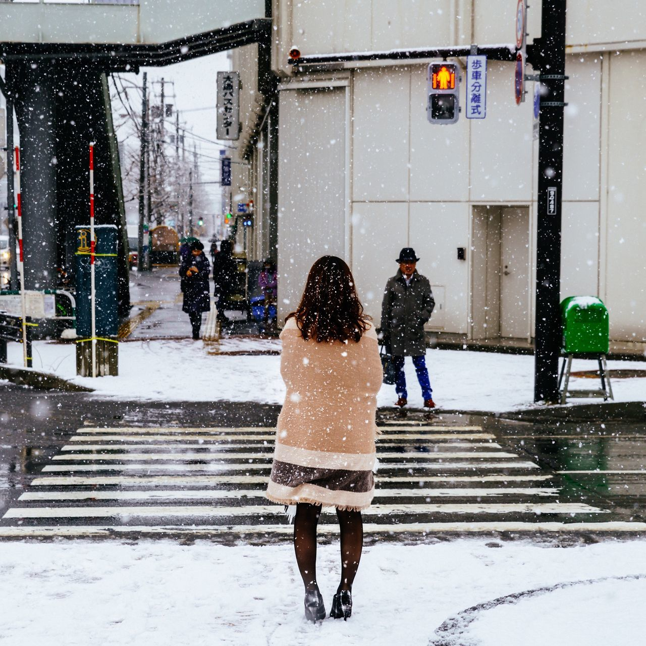 Waiting.... face to face Capture The Moment My Year My View From My Point Of View My Traveling Photography My Street Photography Snow Winter Street Photography Cold Temperature Two People Snowing Sapporo City Street Urban Exploration Urban Photography Sapporo