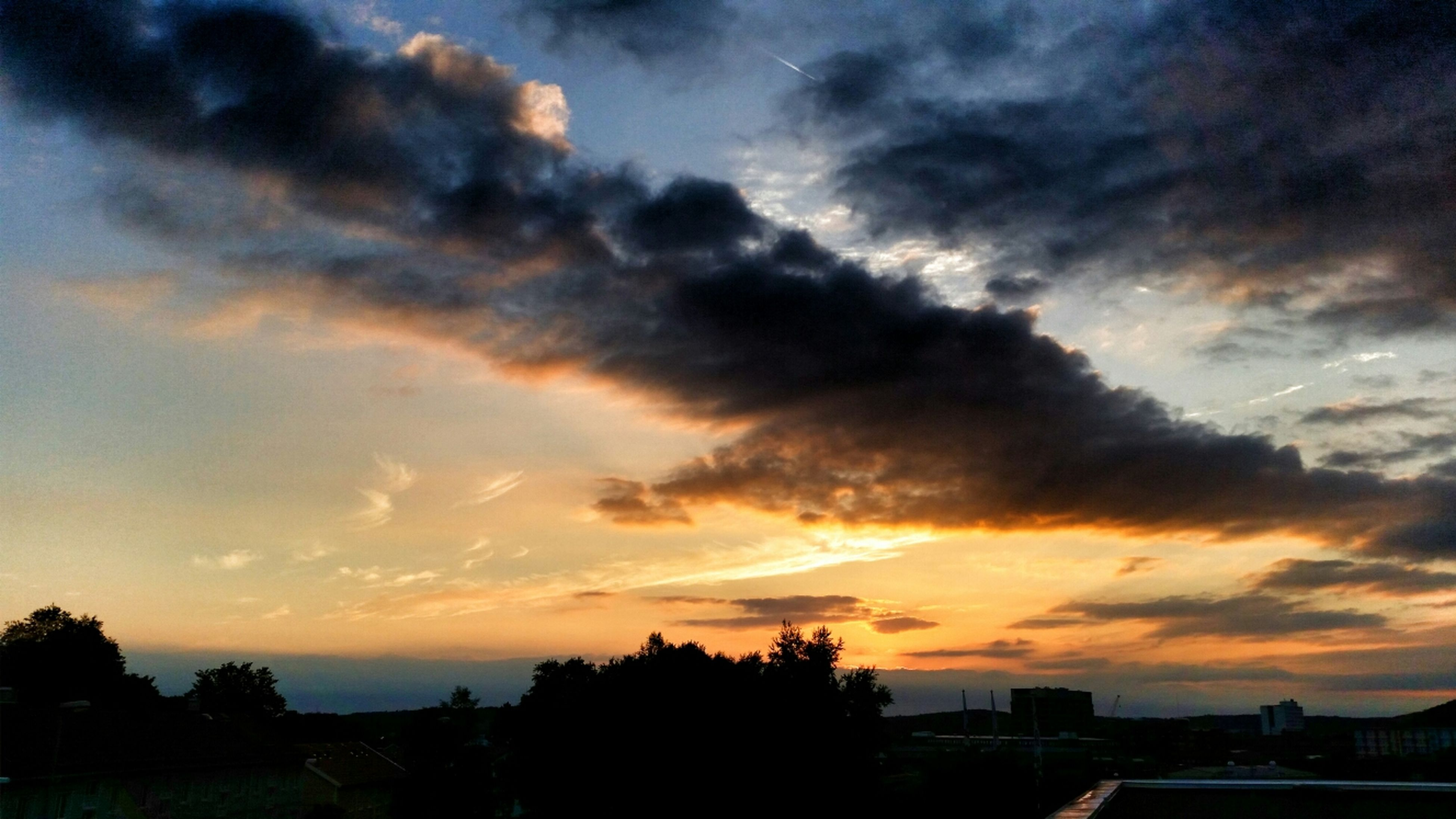 sunset, sky, silhouette, cloud - sky, scenics, beauty in nature, orange color, dramatic sky, cloudy, tranquil scene, cloud, tranquility, nature, tree, idyllic, moody sky, building exterior, weather, built structure, overcast