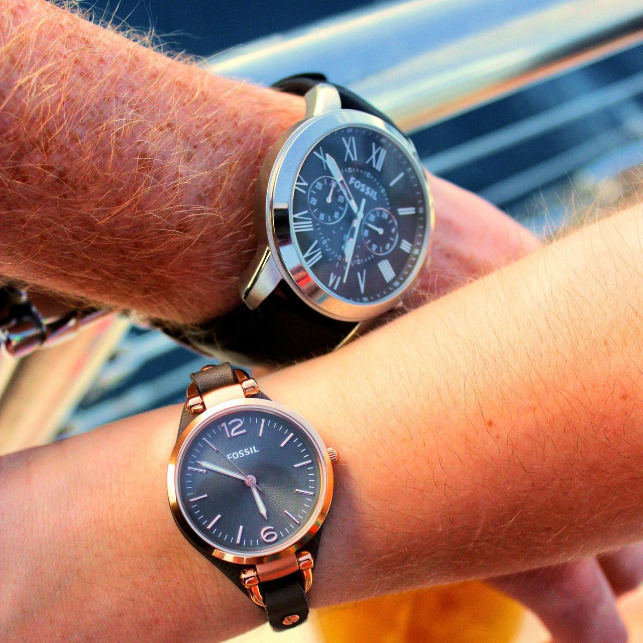Close-Up Of Hands With Wristwatches