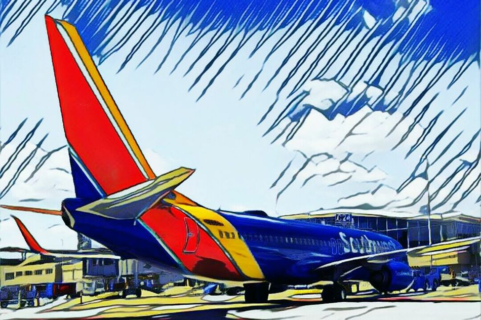 A Southwest Airlines Boeing 737at its gate at C Concourse in Milwaukee, Wisconsin Multi Colored Sky Outdoors Summer Beautiful Transportation Wisconsin Summer Departing Day Blue