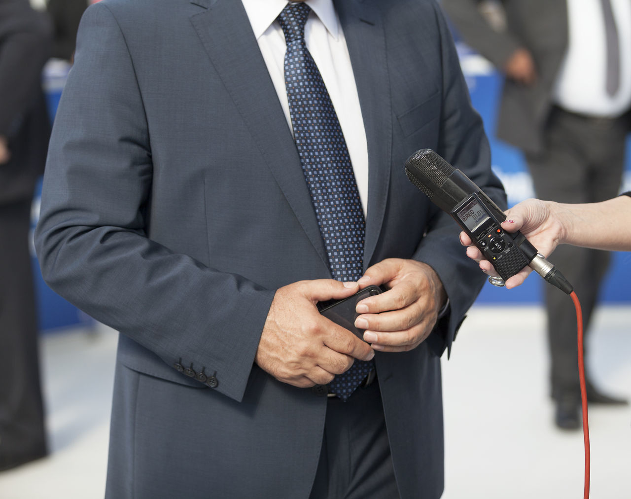 Journalist making interview with businessman or politician Adult Business Businessman BusinessManagementClass Close-up Enjoying Life Event Hand Holding Human Hand Interview Journalist Men Microphone Outdoors People Politician Politicians Press Suit