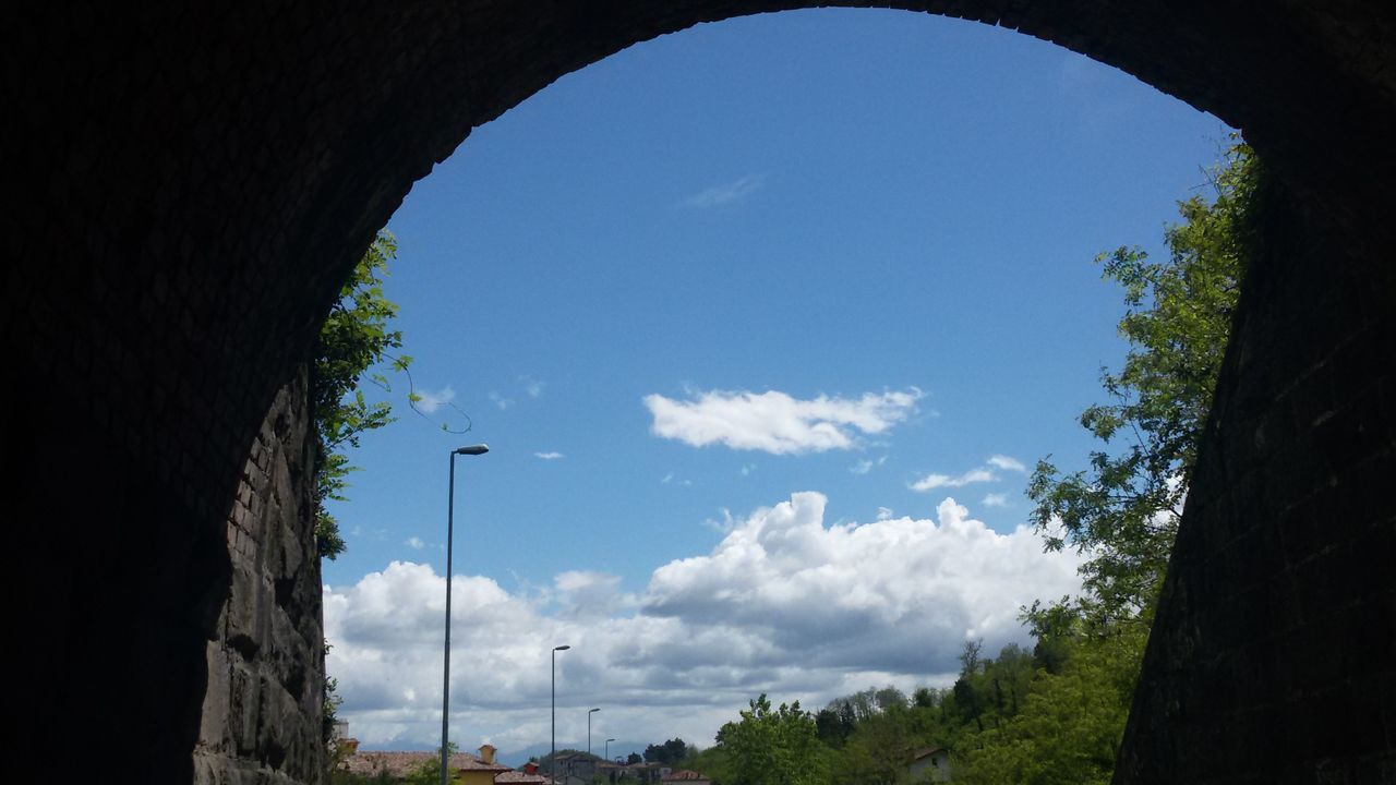 Low Angle View Of Sky Seen From Tunnel