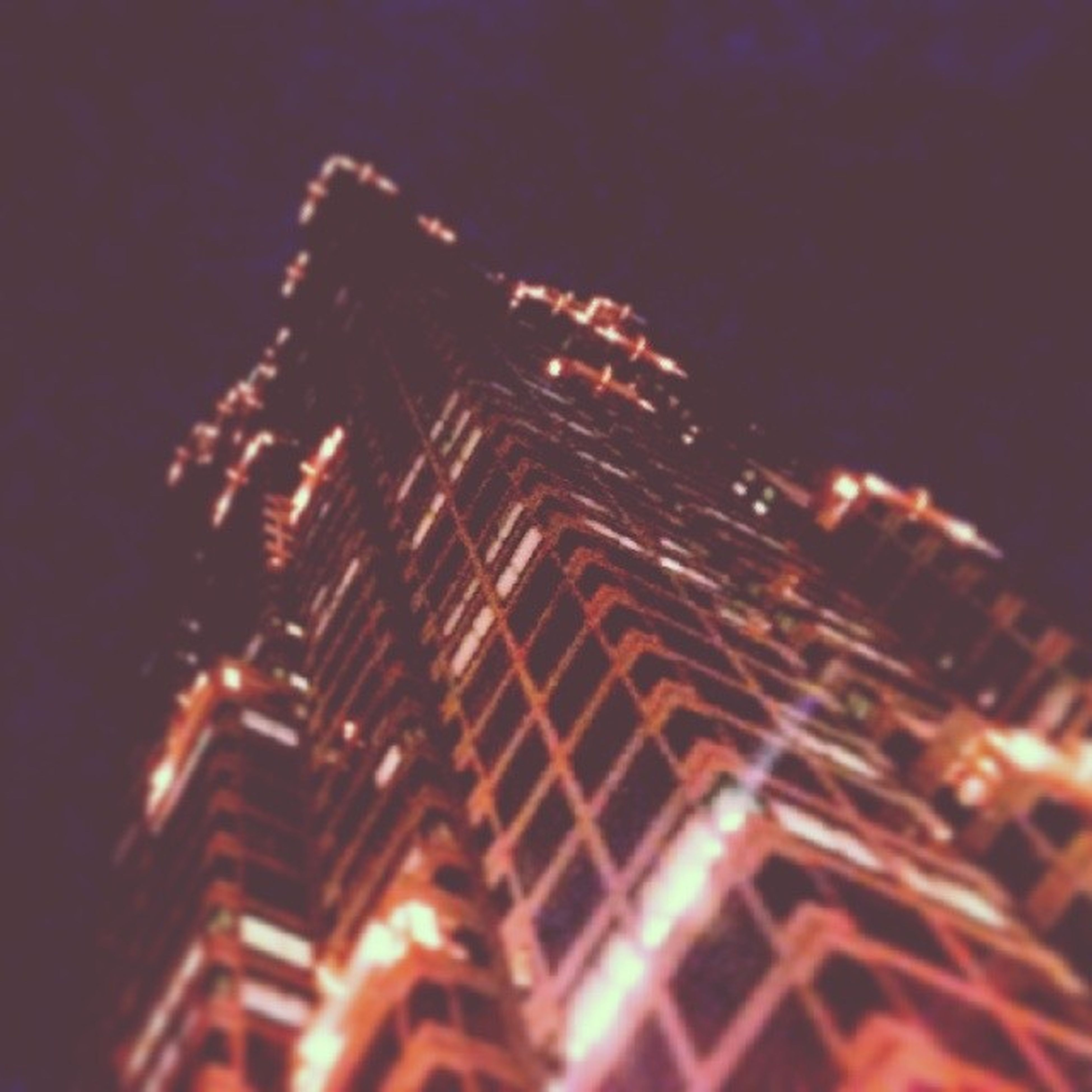 night, illuminated, architecture, built structure, building exterior, low angle view, city, tall - high, sky, tower, skyscraper, modern, no people, outdoors, capital cities, famous place, travel destinations, building, lighting equipment, office building