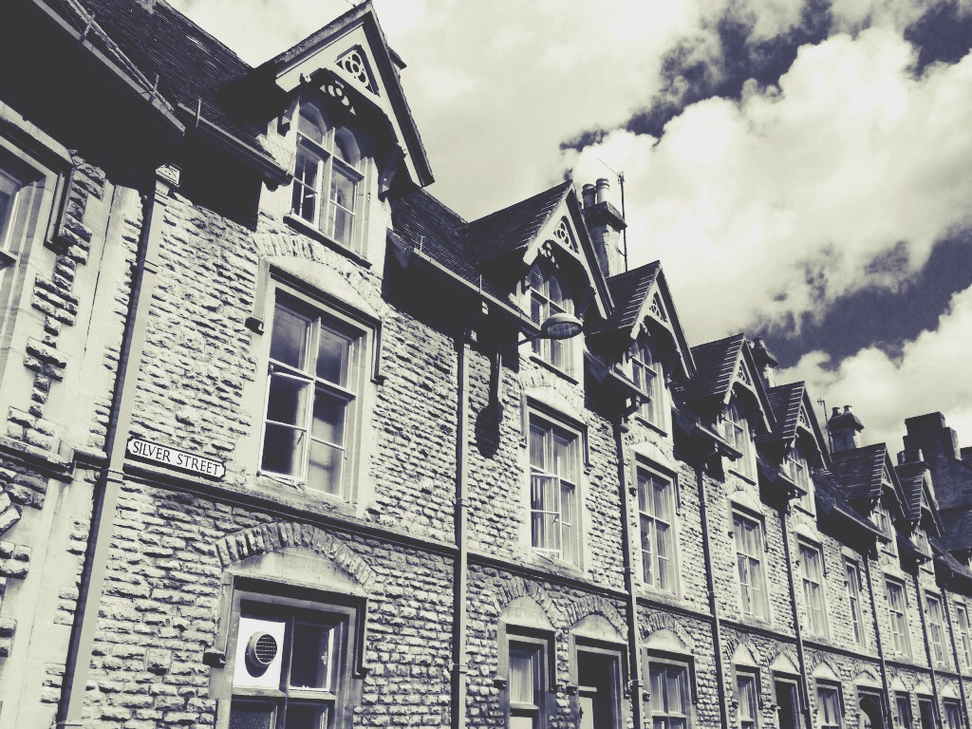 architecture, building exterior, built structure, low angle view, sky, residential building, building, residential structure, window, cloud - sky, cloud, outdoors, house, city, day, old, no people, exterior, cloudy, high section