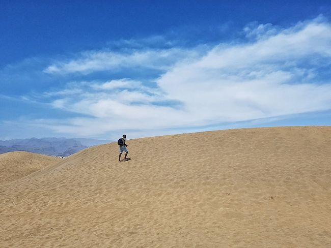 Sand Sand Dune Desert Sky Cloud - Sky Nature Scenics Arid Climate Outdoors Blue Summer Landscape One Person Adult One Man Only Walking In The Desert Thirst Sand Dunes Hot Climate Dry Climate Climbing A Dune Adventure Outdoor Activity 100 Days Of Summer