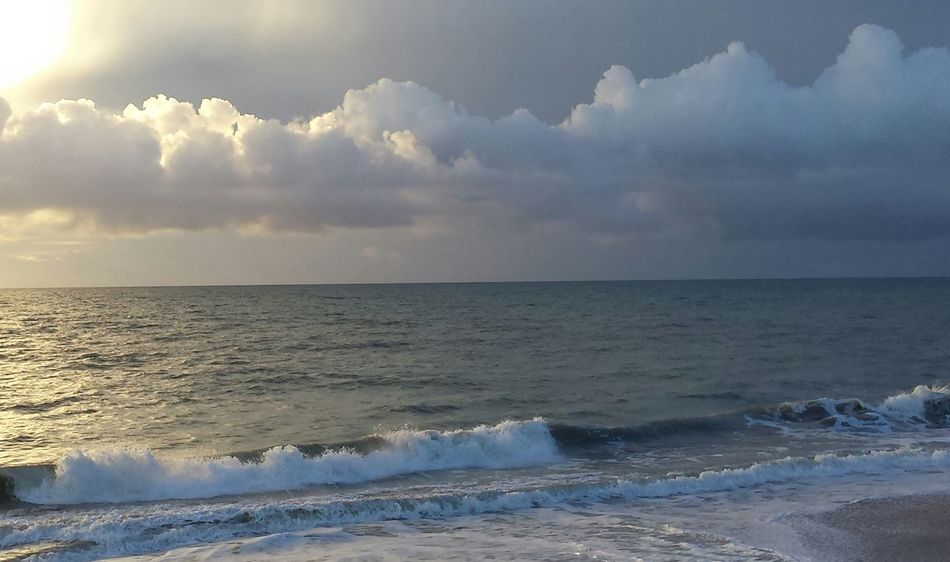 Another one from This Morning's Sunrise Clouds And Sky Sea And Sky Gold And Gray Golden Reflections At The Beach