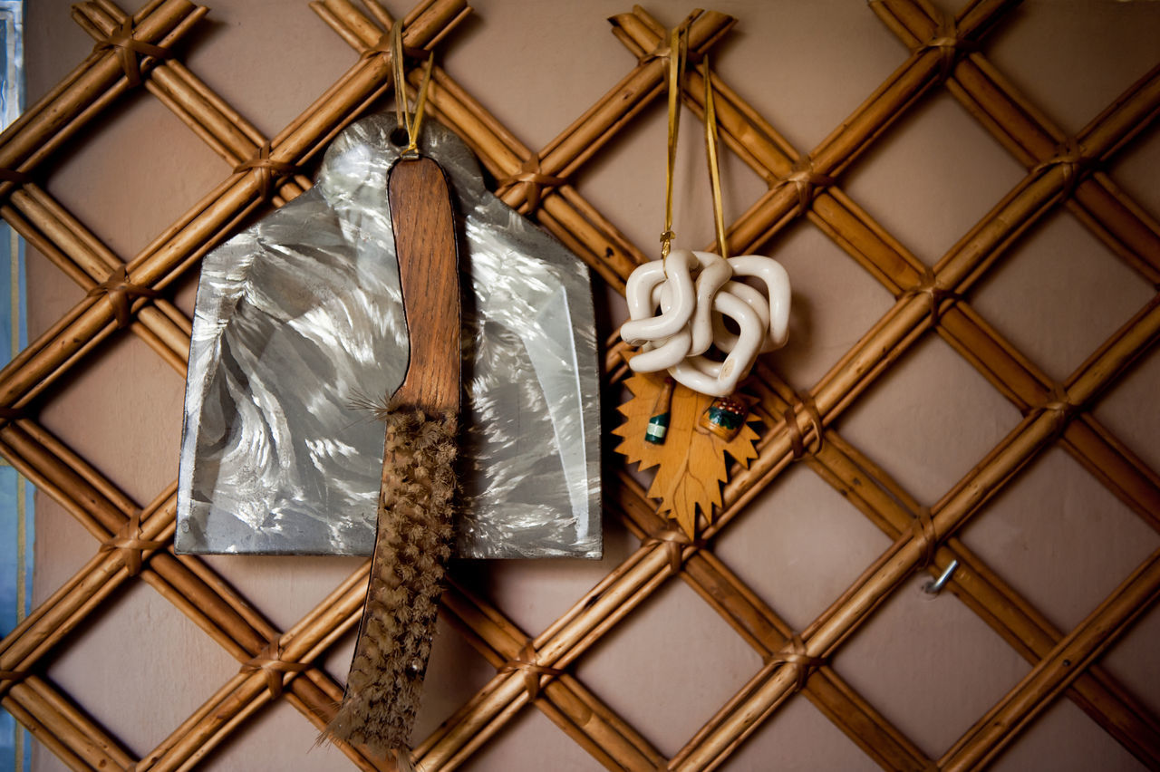 Old retro hand dust brush and dustpan hang on wall, domestic decorative accessories in horizontal orientation, nobody. Accessories Accessory Antique Brush Cleaning Decoration Decorative Domestic Dust Brush Dustpan Hand Dust Brush Hanging Indoors  No People Old Ornate Retro Still Life Sweeper Vintage Wall