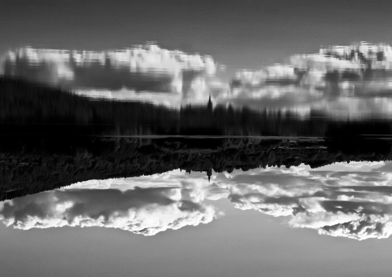 While capturing the shot it was obviously to me that the final image has to be swichted. Cheating brain Beauty In Nature Building Exterior Cloud - Sky Lake In Black And W Nature No People Outdoors Reflection Scenics Sky Sweden Swedish Nature Top Down View Water