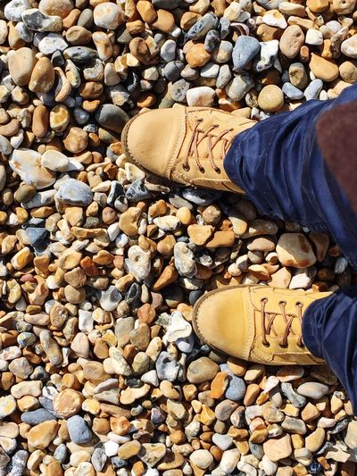 Walk This Way Walk Walking Walking On The Beach Walking On Sunshine Sunny Day Stones And Pebbles Yellow Yellow Shoes