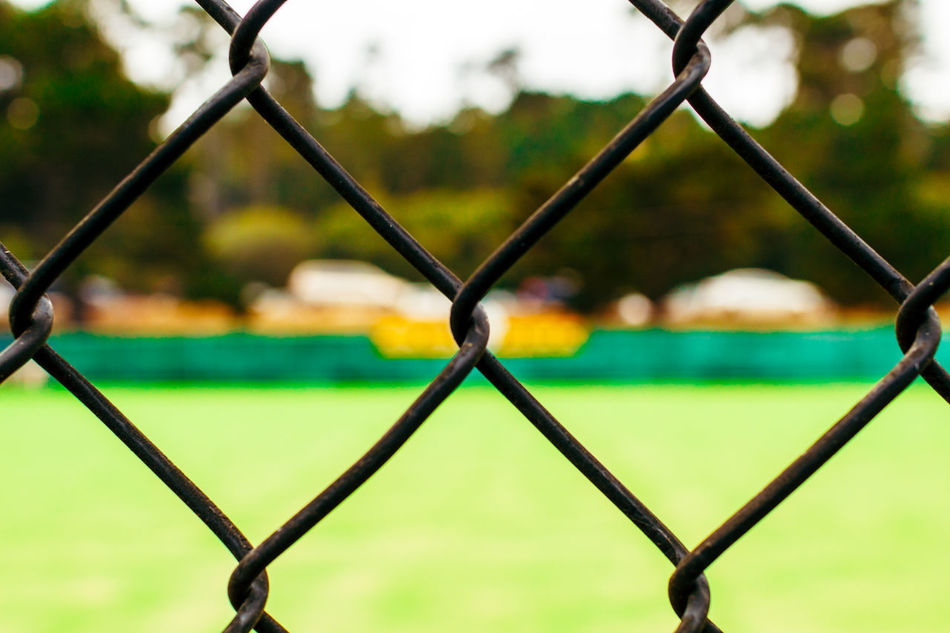 Chain Link Fence Chainlink Fence Close-up Day Fence Focus On Foreground Full Frame Goal Green Lawn Lawn Bowling Lawn Bowls Metal No People Park - Man Made Space Protection Safety Security Soccer Field