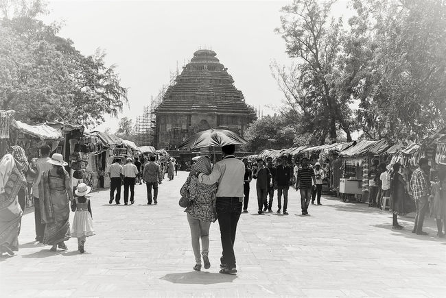 Couple Friends Love Walking Together Built Structure Couples Outdoors People Real People Realtionship Togetherness Umbrella Walking Your Ticket To Europe Mix Yourself A Good Time Sun Temple Konark, Orissa Konark Konark Sun Temple The Week On EyeEm Romance Connected By Travel Black And White Friday Be. Ready. See The Light Perspectives On People EyeEmNewHere EyeEm Ready