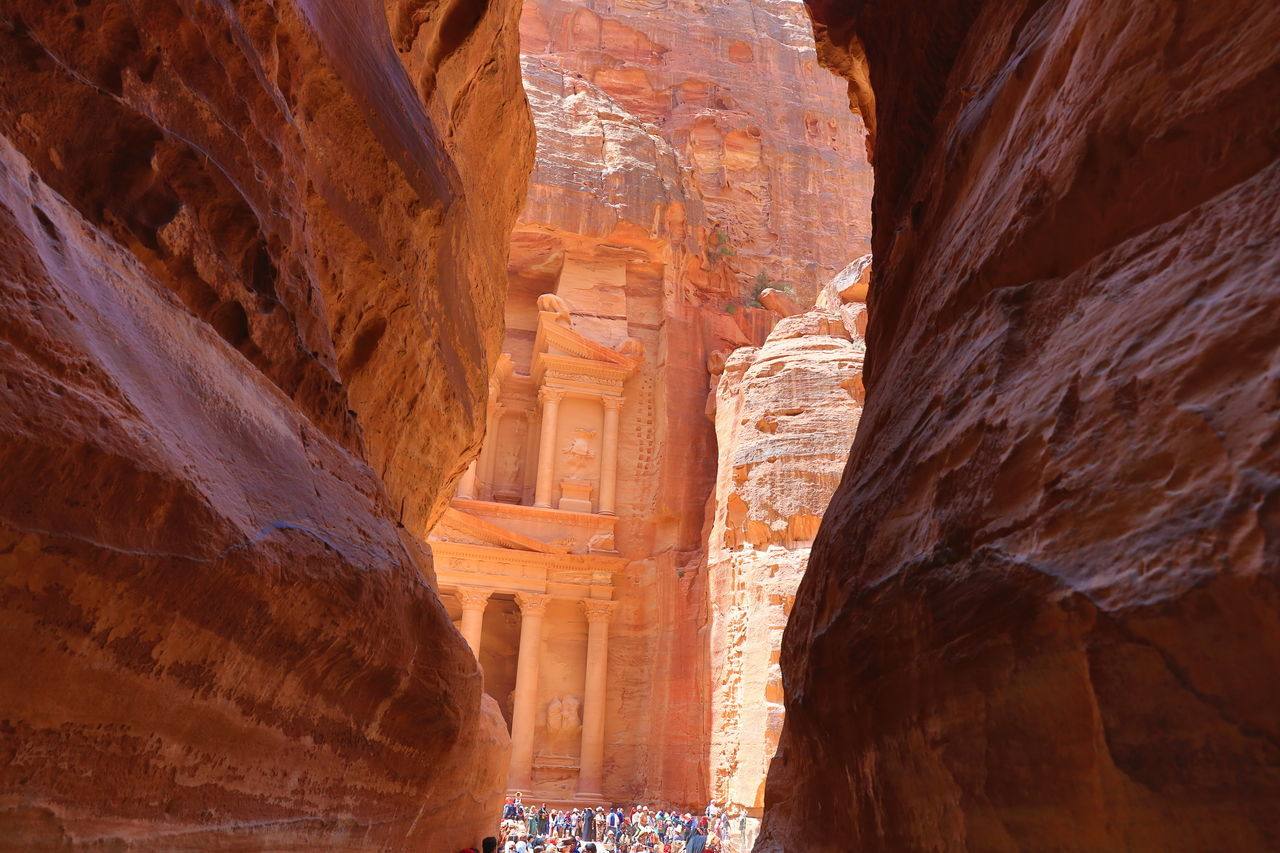 Ancient City Ancient Civilization Arch Architecture Built Structure Cave City In Stone Geology Heritage Site Jordan Jordan Middle East Low Angle View Miracles Of The World Nabataeans Natural Arch Petra Petra Jordan Petra Mountains Physical Geography Rock - Object Rock Formation Sunlight Travel Destinations World Heritage Site