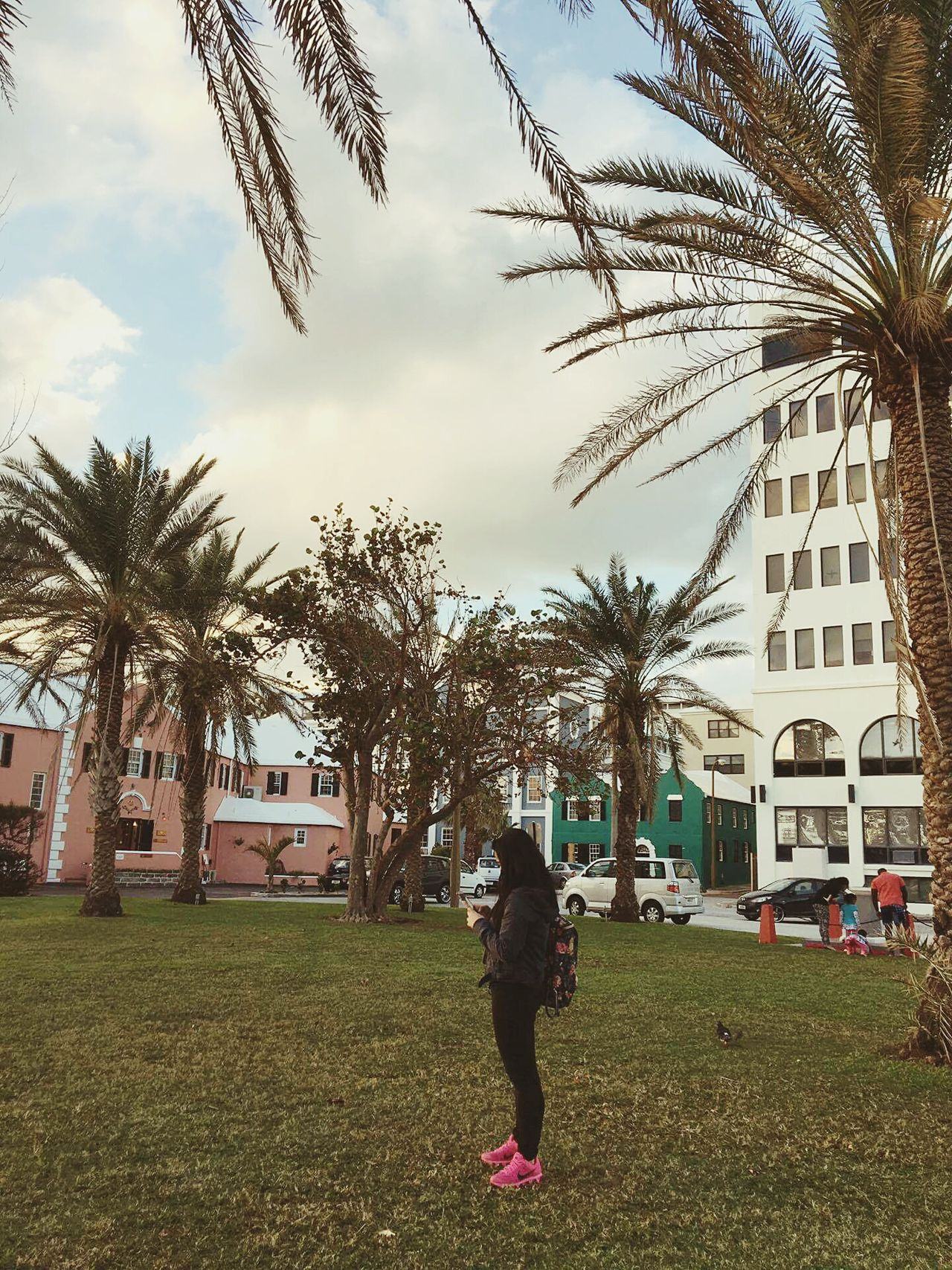 Palm Tree Building Exterior Architecture Outdoors Full Length Palm Tree Building Exterior Architecture Outdoors Full Length One Person People Tree Built Structure Cloud - Sky Sky Playing Day Street Travel Beauty In Nature Leisure Activity Travel Destinations EyeEm Best Shots Streetphotography