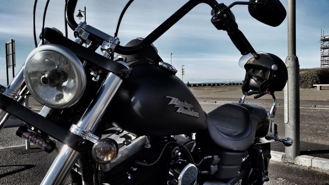 transportation, motorcycle, mode of transport, land vehicle, day, outdoors, no people, stationary, scooter, old-fashioned, speedometer, close-up, sky