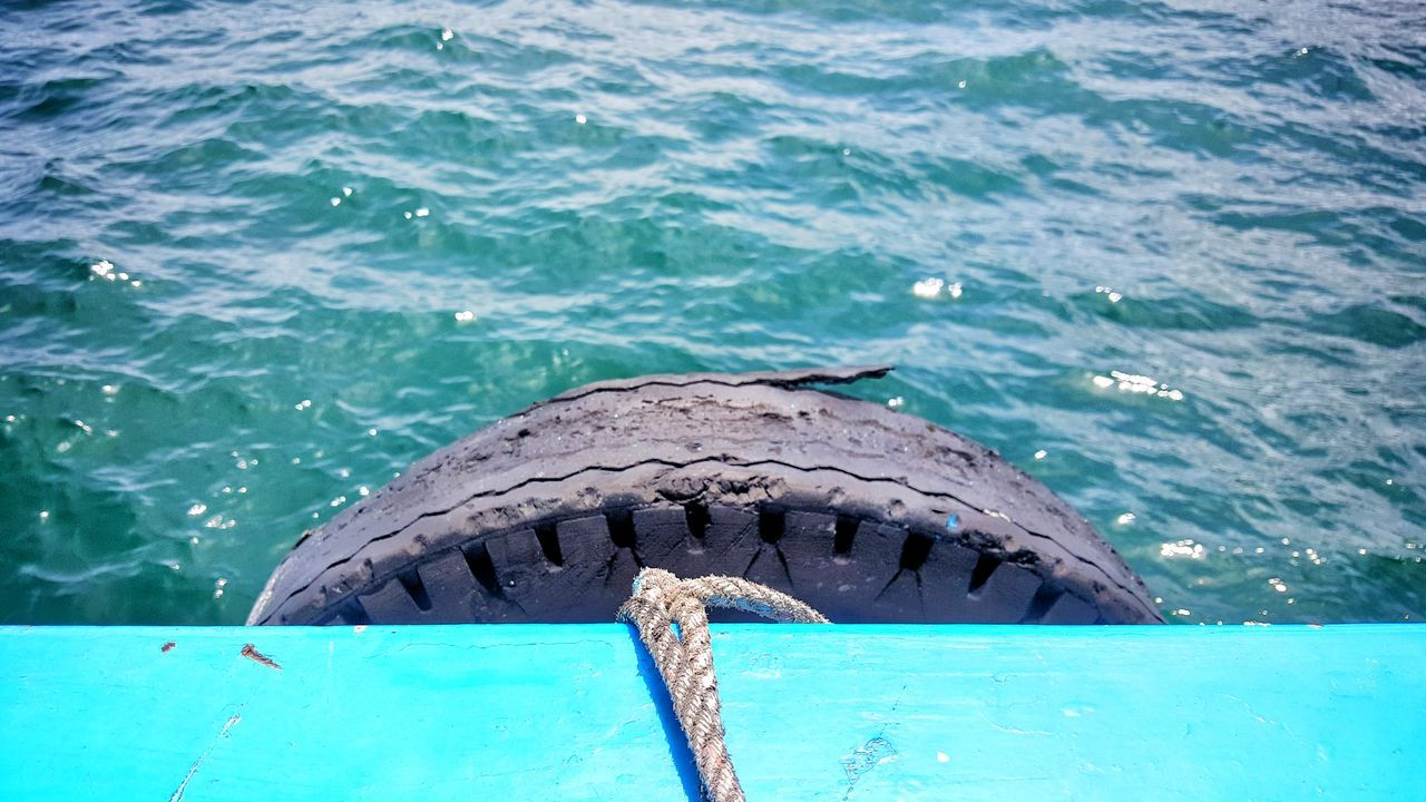 Sea Blue Nature Day Water Underwater Swimming Ship Boat Tire Transportation Sea Life No People Outdoors Across Travel Destination Light Surface Bulwark Wood Recycle View Business Nature