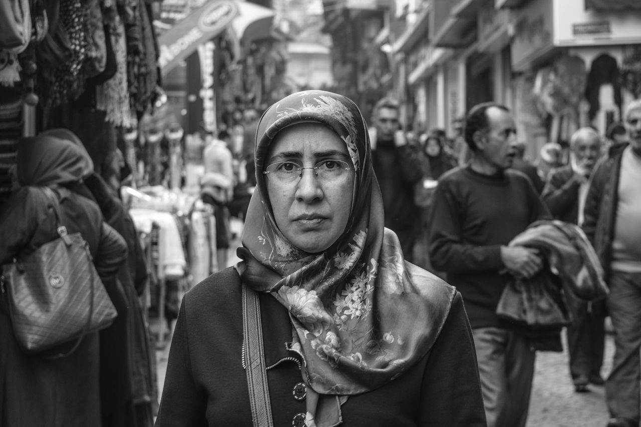 Blackandwhite Casual Clothing City City Life Day Face Focus On Foreground Hiyab Jacket Leisure Activity Lifestyles Musulman Outdoors People Portrait Religion Street Street Photography The Portraitist - 2016 EyeEm Awards The Street Photographer - 2016 EyeEm Awards Turkey Warm Clothing