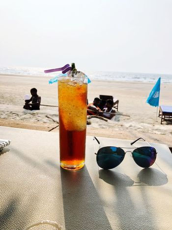 Icetea Goa Beach♥ #goa Beach Sea Sunglasses Sand Horizon Over Water Vacations Shore Water Day Drink Summer Outdoors Drinking Straw Table Food And Drink Drinking Glass Sky Refreshment Real People Nature