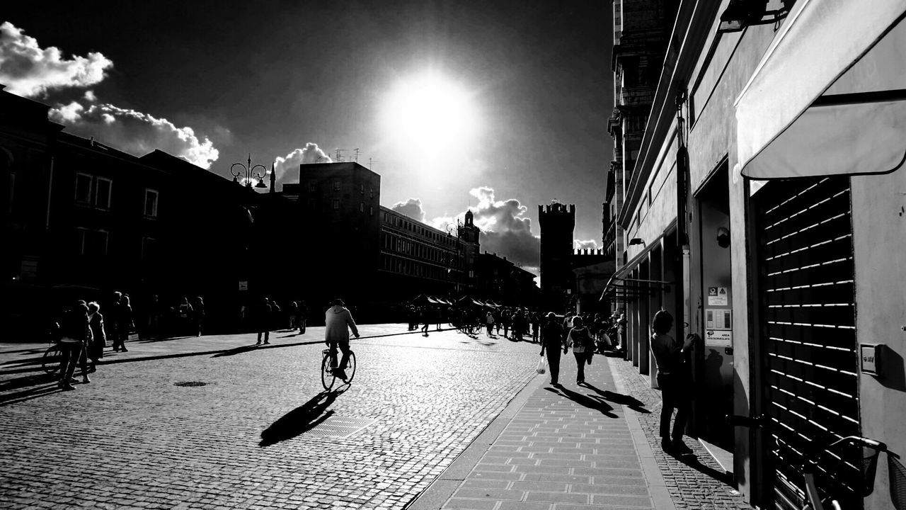 Building Exterior Architecture Built Structure Sunlight City Street Outdoors Shadow Lifestyles City Life Real People Sky Day Sun People Adults Only One Person Only Men Adult