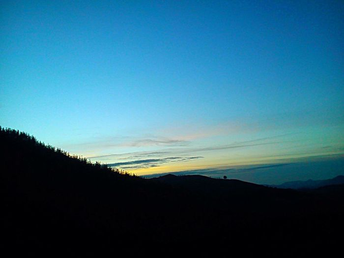 Copy Space Nature Tranquility Scenics Tranquil Scene Beauty In Nature Blue Clear Sky Sunset Landscape Silhouette No People Sky Outdoors Mountain Day