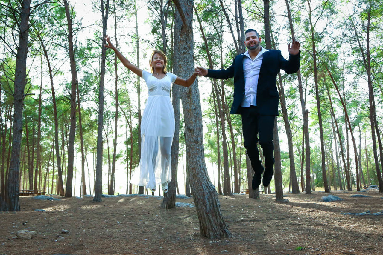 Lets get lifted Two People Full Length Cheerful Happiness Nature Smiling Motion Forest Outdoors Day EyeEm Eyestoriestudio Sound Of Life Oh The Places We'll Go People Wedding Weddingday  Wedding Photography Urbanbride Popular Portrait