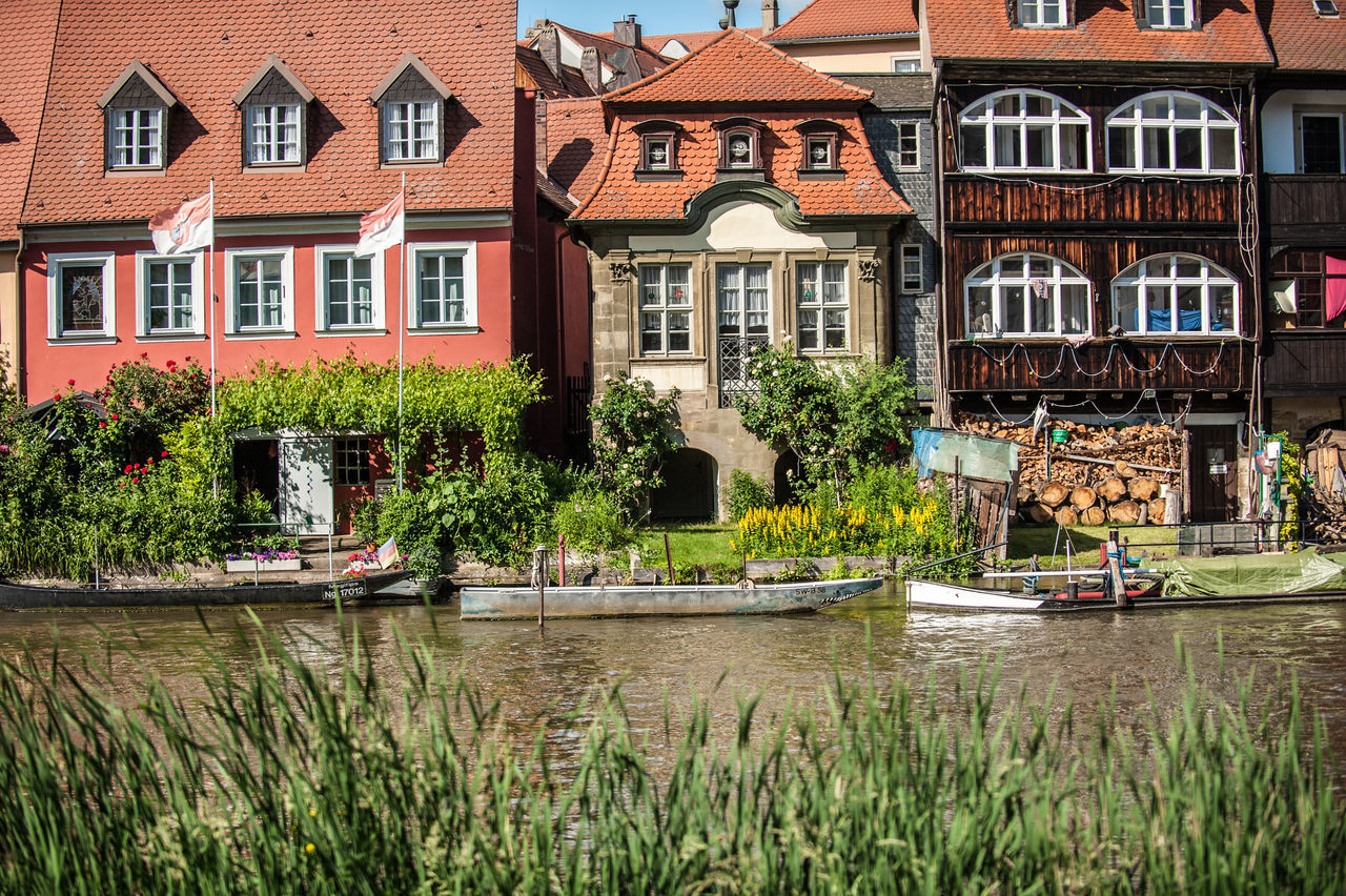 Architecture Building Exterior Built Structure Canal City Façade Green Color Growth House In Front Of Lawn No People Outdoors Plant Residential Building Residential District Residential Structure River River Regnitz Riverbank Tourist Resort Town Water Waterfront Window