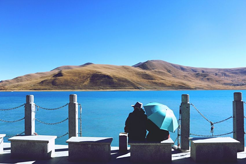 Clear Sky Mountain Real People One Person Blue Rear View Nature Day Outdoors Men Mountain Range Scenics Beauty In Nature Sea Water Standing Lifestyles Sky Adult Adults Only Lost In The Landscape Connected By Travel EyeEmNewHere