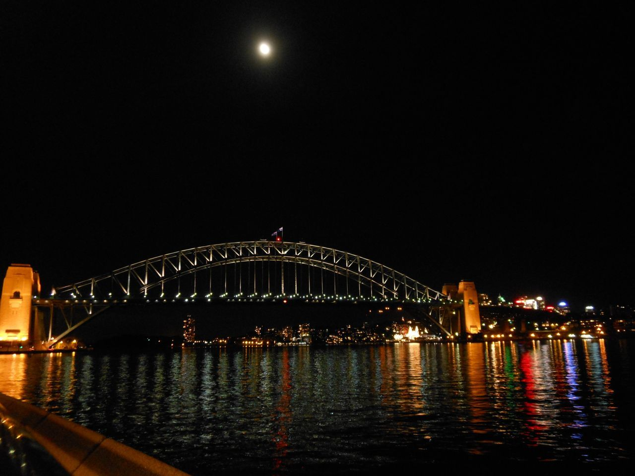 Sydney Harbour Bridge at night Architecture Black Water Bridge Bridge - Man Made Structure City City Trip Citylife Citylights Colourful Dark Darkness And Light Evening Walk Illuminated Lights In The Dark Mirroring In Water Moon Night No People Outdoors Sydney Harbour Bridge Sydney, Australia Tranquil Scene Travel Destinations Travelling Waterfront