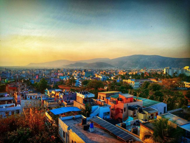 City Life Crowded City High Angle View Sunset Sky Scenics Rooftop India Visakhapatnam Beautiful Sunset Beautiful India Architecture Built Structure Building Exterior Cityscape City High Angle View Sunset Residential Building Crowded Mountain Residential District Illuminated Sky First Eyeem Photo