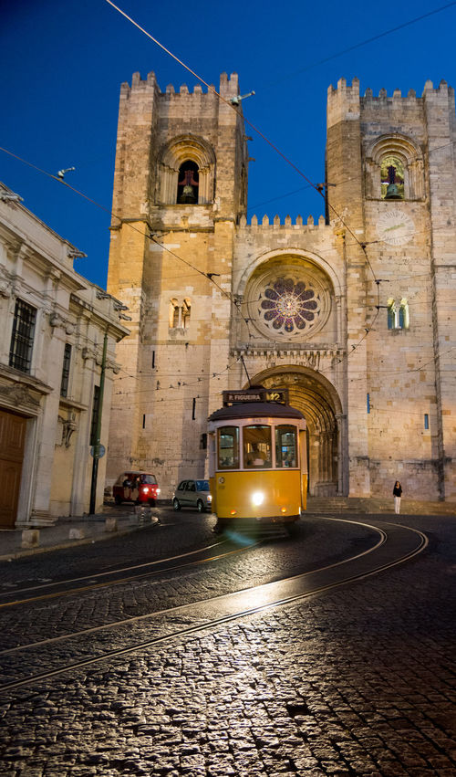 Electrico, Alfama, Lisbonne Electrico28 Architecture Bell Tower Building Exterior Built Structure City Day Electrico De Lisboa Electrico Lisboa Eléctrico No People Outdoors Place Of Worship Religion Sky Spirituality Transportation