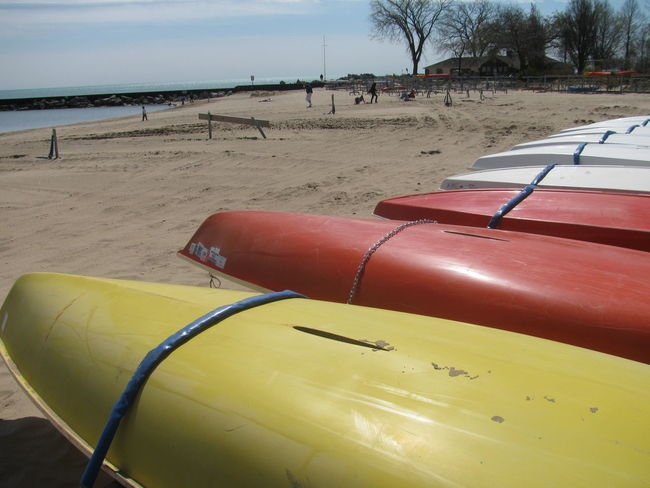 Boats Canoes City Life Day Outdoors Recreational Pursuit Red Scenics Sky Tourism Tranquil Scene Tranquility Vacations Vibrant Color Weathered