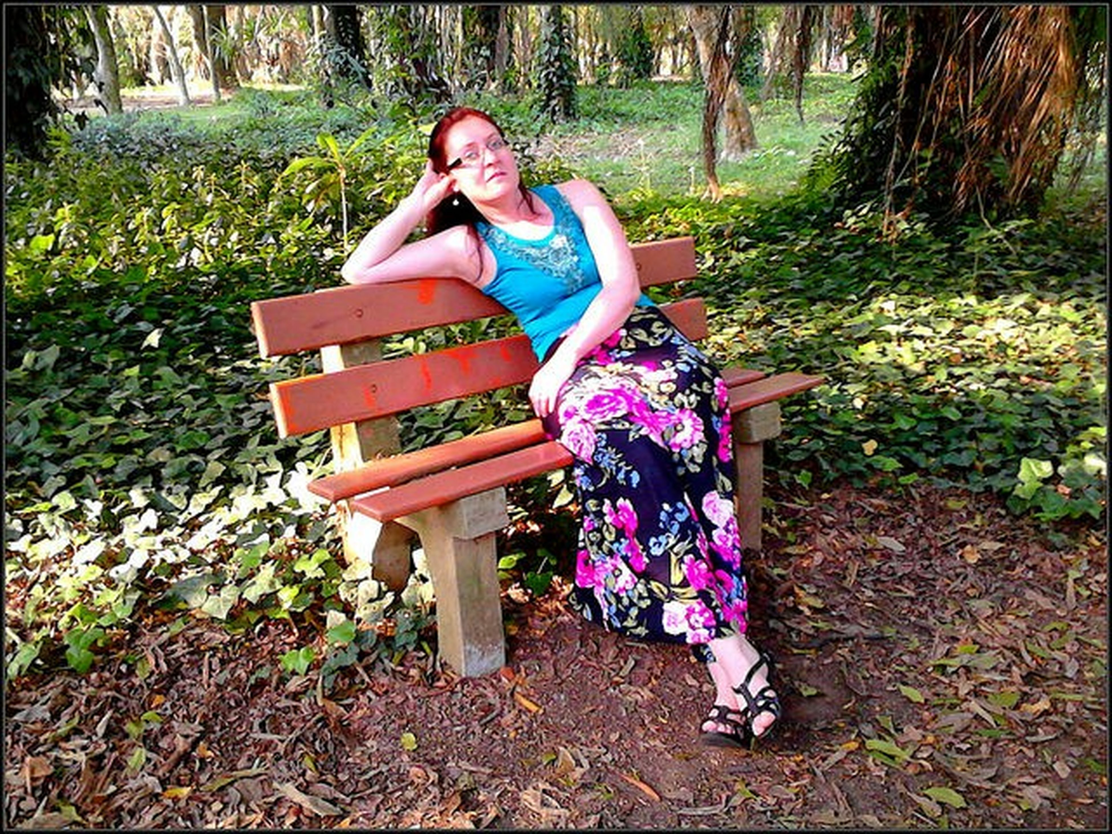 wood - material, sitting, full length, tree, childhood, day, lifestyles, bench, leisure activity, casual clothing, outdoors, park - man made space, relaxation, grass, front or back yard, chair, nature, dress
