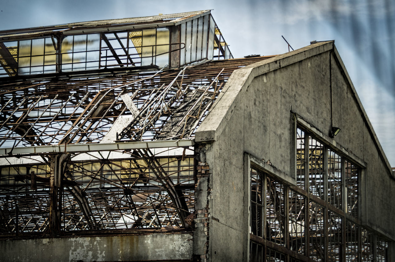 architecture, built structure, railing, low angle view, no people, day, sky, outdoors, building exterior, industry, factory