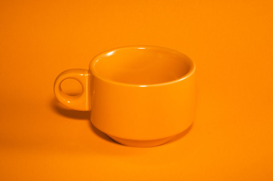Orange Coffee Cup Close-up Coffee Coffee Cup Cup Drink Food And Drink Indoors  Orange Preparation  Refreshment Shiny Simplicity Still Life Studio Shot Table Tea Cup First Eyeem Photo Market Bestsellers June 2016 Bestsellers