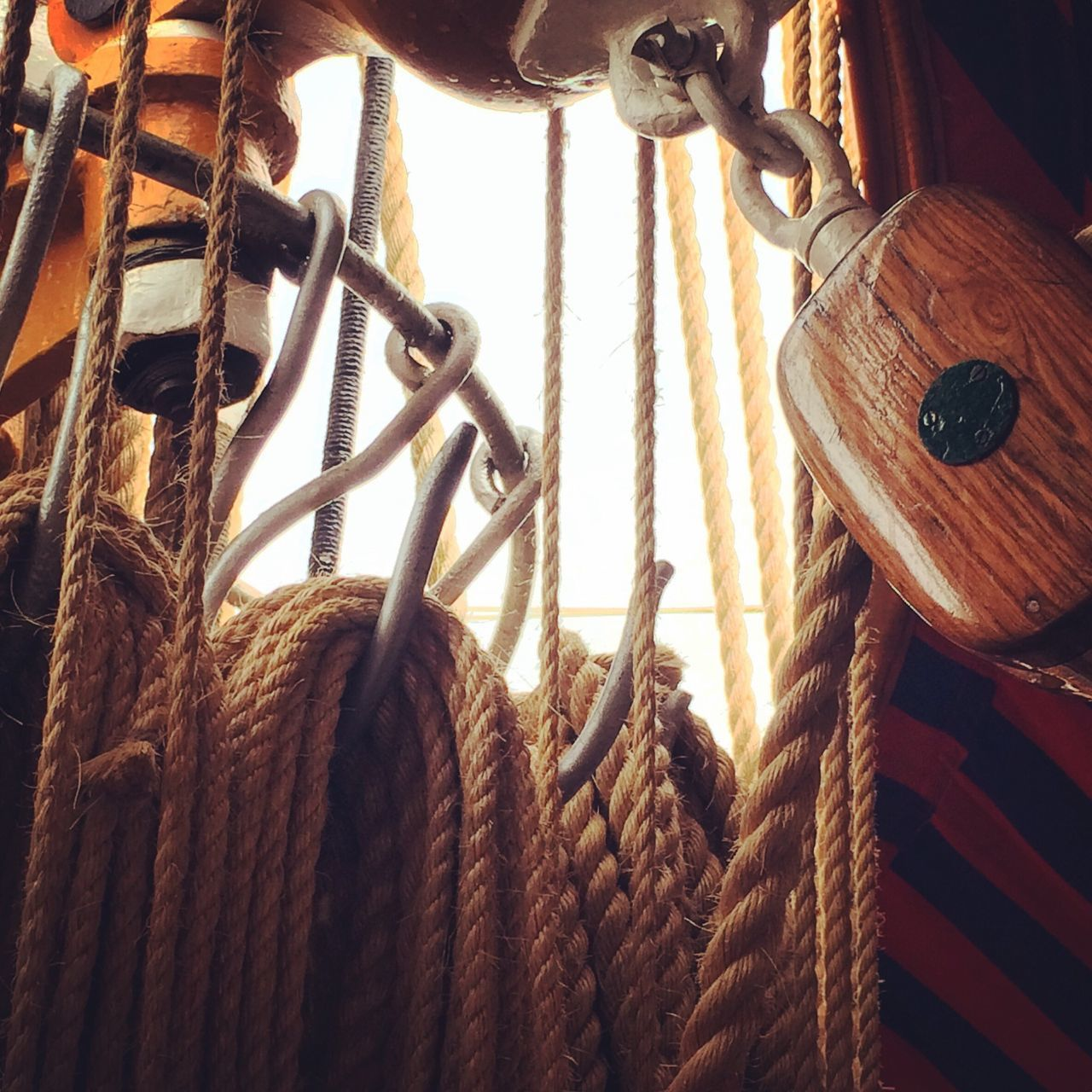 Low Angle View Of Ropes Hanging On Ship