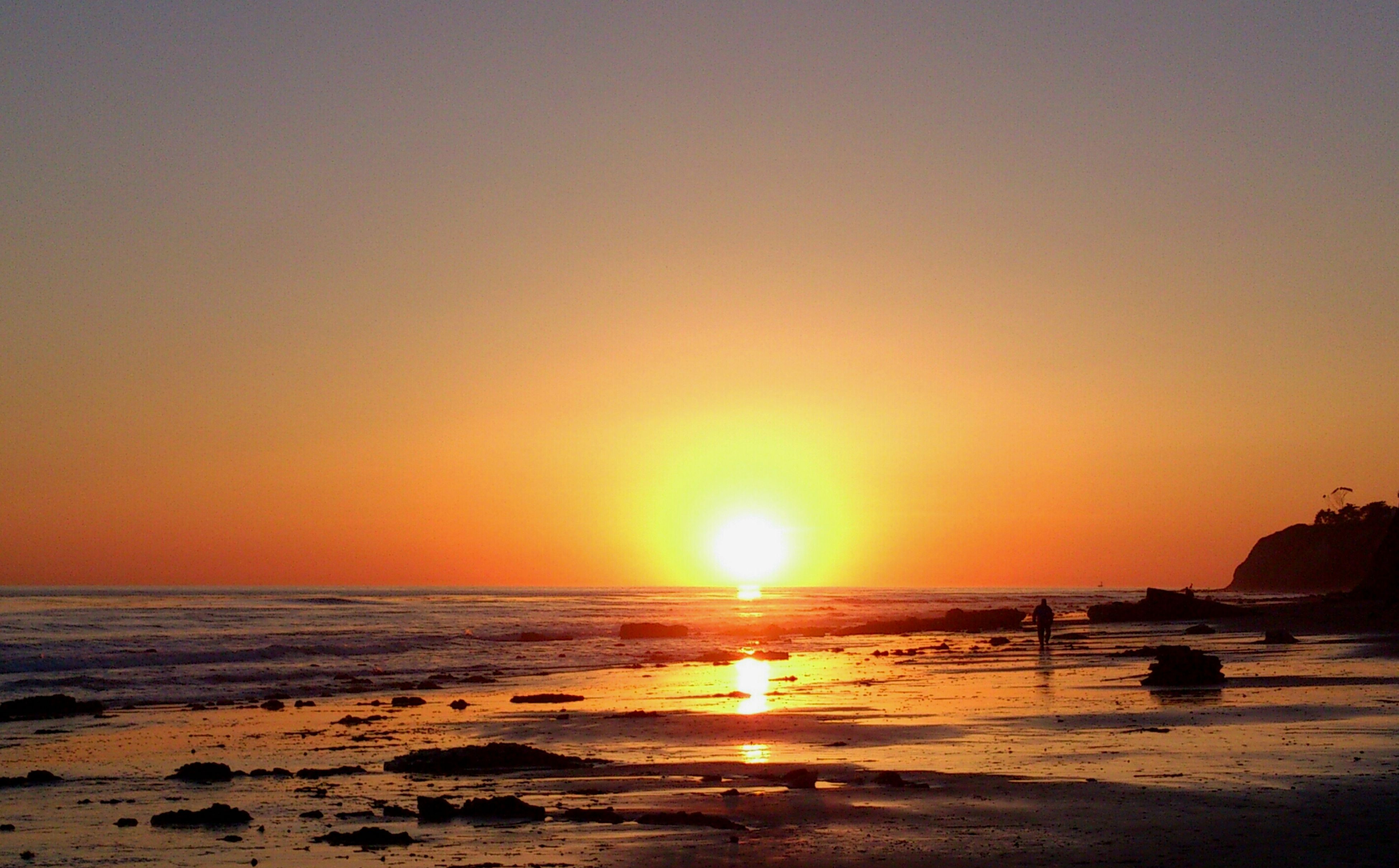 sunset, sea, beach, water, horizon over water, sun, scenics, tranquil scene, shore, tranquility, beauty in nature, orange color, idyllic, nature, sand, clear sky, reflection, sunlight, copy space, coastline
