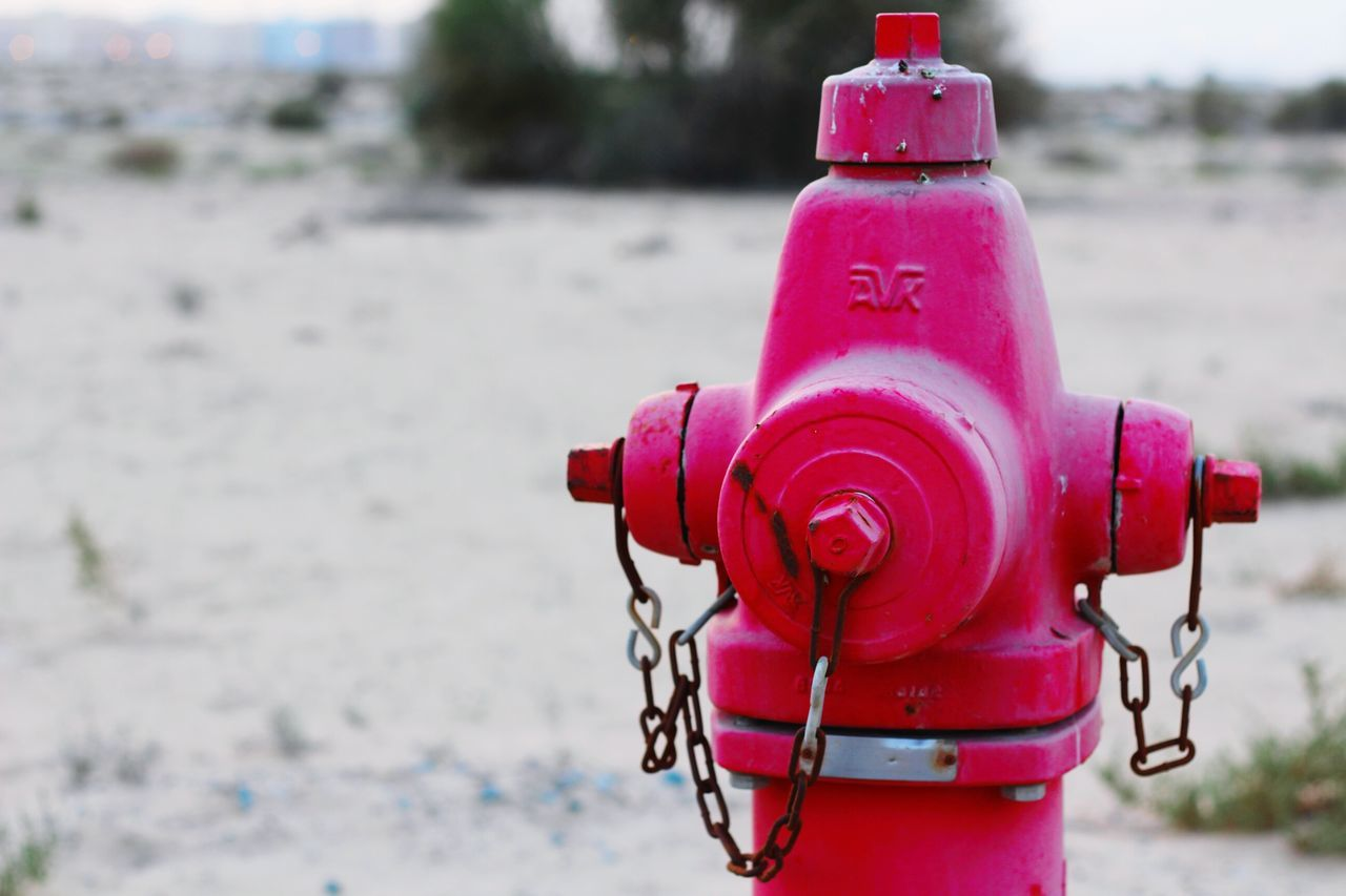 metal, safety, day, focus on foreground, outdoors, no people, red, fire hydrant, close-up, water, nature, sky