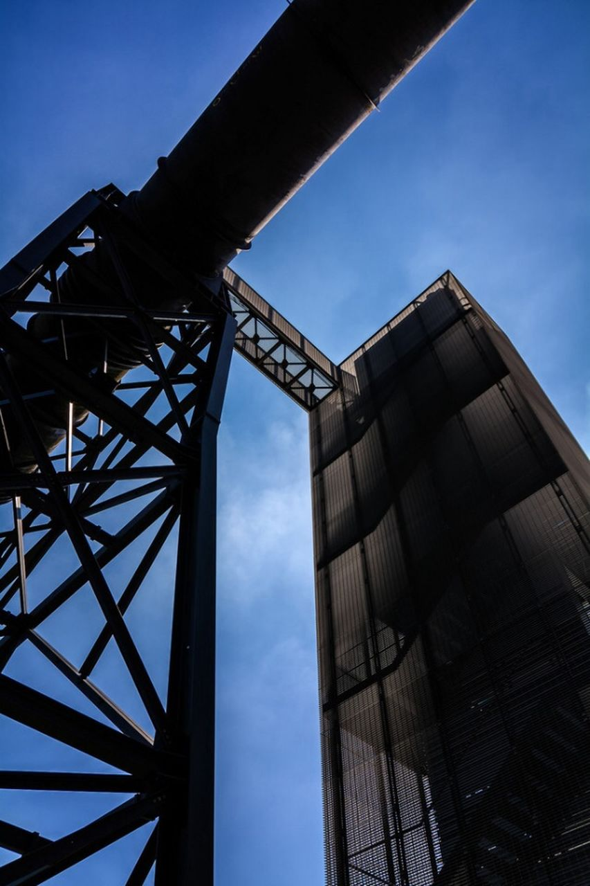 low angle view, sky, metal, built structure, industry, architecture, no people, outdoors, day, blue, steel, girder, metal industry