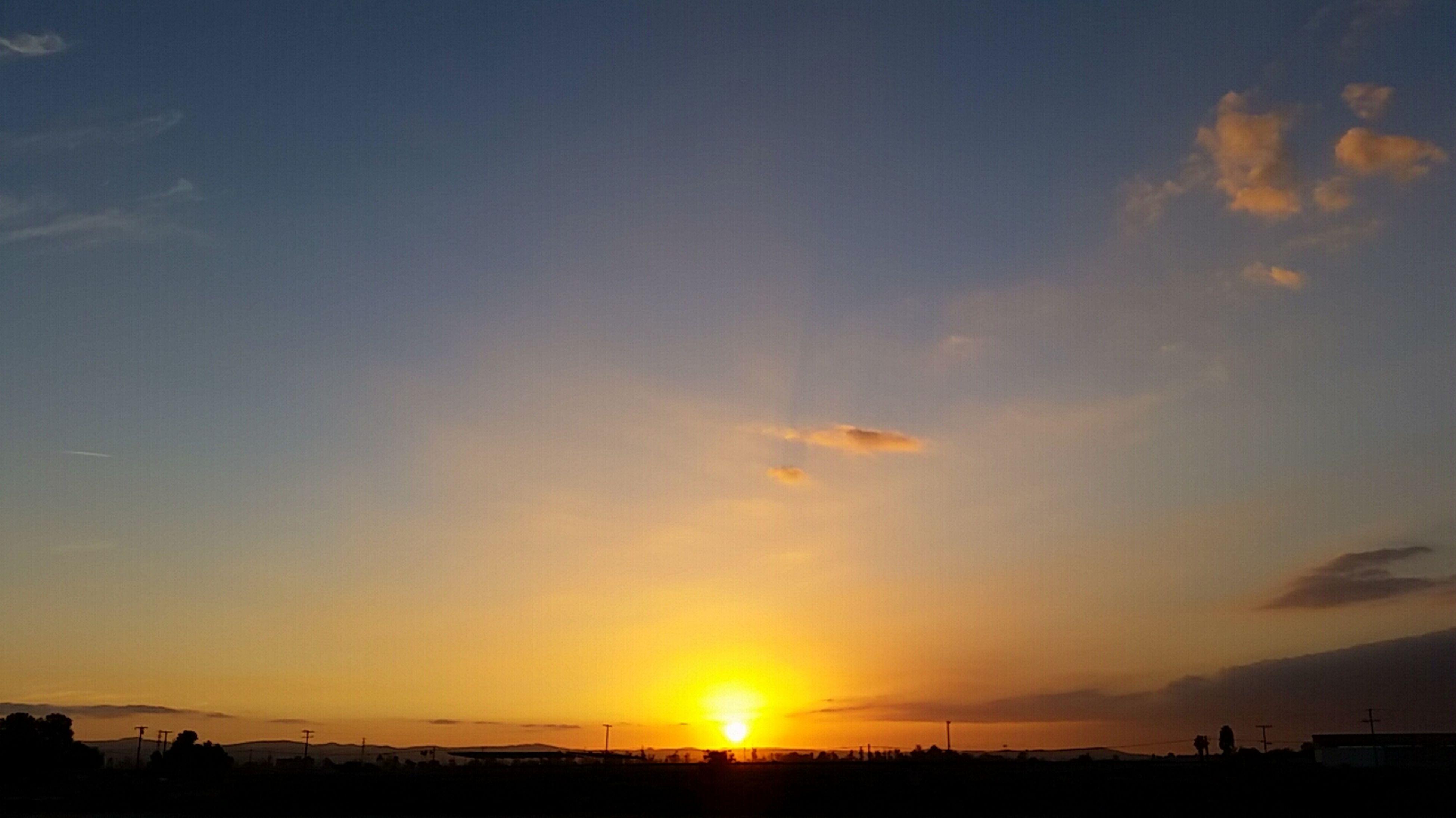 sunset, sun, sea, water, scenics, tranquil scene, beauty in nature, horizon over water, sky, silhouette, tranquility, orange color, beach, nature, idyllic, sunlight, sunbeam, shore, incidental people, outdoors